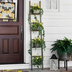This Galvanized Metal Ladder Planter features a wooden frame with four metal boxes to hold your favorite plants. It is a unique accent to your seasonal flowers.