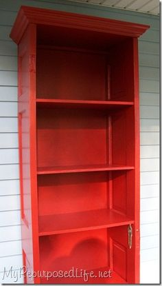 Old door into a shelf....because we NEVER have enough book shelves in our house!
