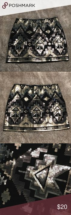 Black Sequin Mini Skirt This black mini skirt is super sexy and still comfy. It's black with a silver/gray and gold sequined pattern. Could fit a S also! Worn once, in like new condition!   🖤All items are in great condition and come from a smoke-free home 🖤I consider reasonable offers 🖤Bundle 3+ items for 15% off 🖤I do not model, but feel free to ask for more pics 🖤Comment if you have any questions Express Skirts Mini