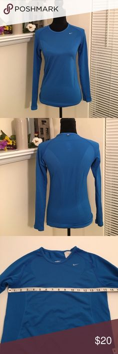 Nike Fit long sleeve tee Bright blue long sleeve NikeFit tee. Honeycomb type fabric for the sleeves and rubbed texture at the sides. Crewneck style. Nike Tops Tees - Long Sleeve