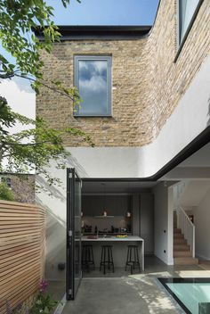 This refurbished and extended London house includes a pop-up screening room for the owner, who works for film company Universal Studios.