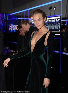 Ready to be an Angel? Millie looked as if she could have joined the squad as she worked the room alongside VS model Vita Sidorkina