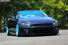 Volkswagen Eos with Scirocco front-end conversion, on turquoise blue WatercooledIND CC10 wheels. Air Suspension. Custom interior by FATMOON. Custom Titanium Exhaust. | Photos by Kumax - STANCENATION.