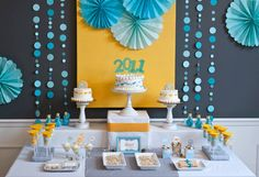 Teal and yellow really pop against this grey backdrop of this party.