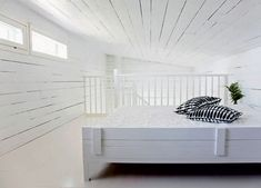 Lollo's Design Files: Finnishing Touch: The main bedroom is characteristically white and bright. I love the use of white timber on the walls and ceiling – it somehow adds warmth in a stark room. And same materials and colours have been used for this bed which make it transparent and almost invisible! Image from BoligLiv Photography Krista Keltanen