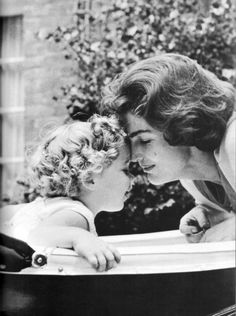 Caroline and John jr. ( I believe this is Jacquie Kennedy with Caroline in the carriage) | followpics.co