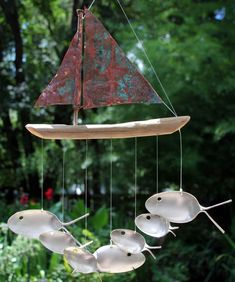 Copper and Driftwood Windchime - Seven Sailing Spoonfish. $64.95, via Etsy.
