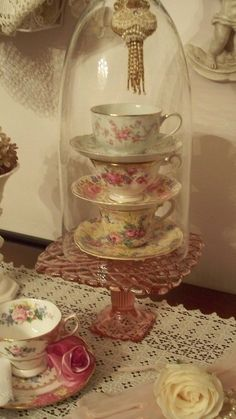 Cups and saucer cloche.