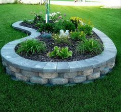 Landscape Ideas Images. Raised flower bed. Love this idea for around a well or the gas tank to prevent weed eating!