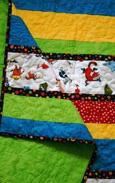 This adorable strip quilt is made with Robert Kaufmans celebrate Seuss fabric. It features all of Dr Seusss wacky characters including the Grinch, Cat in the hat, Thing 1 and Thing 2, Sam I am and so many more. I added fun complimenting strips of red, green, blue and yellow to make a small baby or toddler quilt that any child would love. Made with quilt shop quality fabrics, warm and natural batting and machine quilted with clear nylon thread on top and green on the back. The back of the…