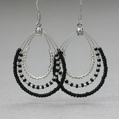 Black and white sea beads big tear drop hoop earrings handmade ani designs Jade Earrings, Diy Earrings, Teardrop Earrings, Crystal Earrings, Earrings Handmade, Handmade Jewelry, Hoop Earrings, Jewelry Dresser, Bijoux Diy