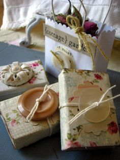 Big vintage buttons on top of fabric-wrapped matchstick boxes - so cute!