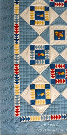 I Spy quilt with a zillion tiny flying geese. As-ever great quilting by Judi Madsen of Green Fairy Quilts: grid, point to point, arrowheads extend the geese into the border. Long Arm Quilting Machine, Machine Quilting Patterns, Longarm Quilting, Free Motion Quilting, Quilting Projects, Quilt Patterns, Quilting Ideas, Flying Geese Quilt, Custom Quilts