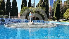 Funny Clown with accordion, a children's fountain at the circus, Sochi landmark