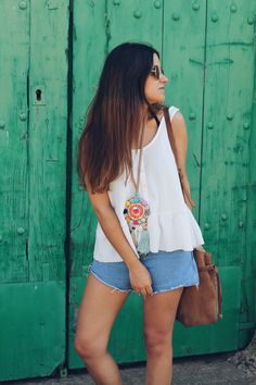 summer outfit wearing denim shorts, ethnic necklace and suede bag More on: http://www.littleblackcoconut.com/2016/07/boho-touch.html