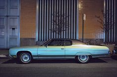Silver Fish, Chevrolet Impala Custom Coupe, in front of Con Edison substation, 1975.