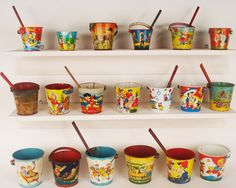 More beautiful vintage beach sand pails. What a colorful accent for a beach style bathroom.
