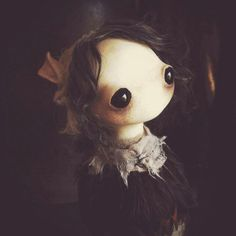 Mahlimae doll, big eyes, sad, no nose. no lips, ribbons in hair, dress, lace, brunette