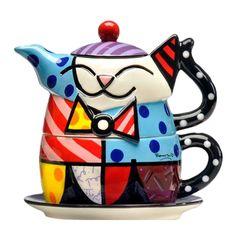 Conjunto Xícara e Bule Cat - Romero Britto - em Cerâmica - 18x15 cm Nada melhor que tomar sua bebida quente predileta no conforto de sua casa! Pensando nisso, peças para chá e café são indispensáveis nessas horas. Então que tal tornar esses momentos mais alegres e marcantes com peças que transmitem isso a seu ambiente? O conjunto Tea For One Cat, da linha Romero Britto, é a peça perfeita para este propósito!