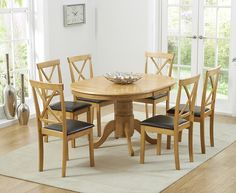 Buy the Epsom Pedestal Extending Dining Table with Chairs at Oak Furniture Superstore