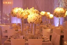 ivory and metallic table setting.. I love tall center pieces  | followpics.co