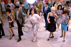 """The movie """"Hairspray"""", set in early Baltimore, written and directed by John Waters. Seen here front and center, Ricki Lake (as Tracy Turnblad) dancing to The Madison. Ricki Lake, John Waters, Serious Business, Practical Magic, Costume Institute, Back To The Future, Director, Historical Costume, Hairspray"""