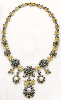 A 19th century antique gold, silver, pearl, sapphire and diamond Necklace. Designed as a series of florets set with button pearls, sapphires and diamonds, mounted in silver and gold. #antique #necklace
