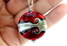 Fabulous Dark Red Glass Bead Pendant, SRA, Lampwork Jewelry, Sterling Silver, Glass Bead Lentil, Lampwork Glass, Swedish Handmade by MarianneDegener on Etsy