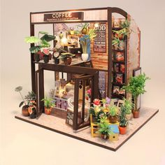 Hoomeda Coffee House DIY Dollhouse With Music Motor Cover Light Miniature Model Toy Gift Sale - Banggood Mobile Dollhouse Kits, Dollhouse Miniatures, Sierra Leone, Sri Lanka, Diy Casa, Diy Gifts For Friends, Miniature Houses, Kit Homes, Miniture Things