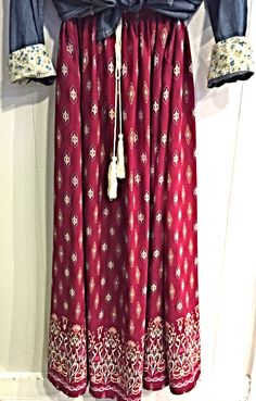 Diamonds Are A Girl's Best Friend Skirt - This printed burgundy skirt is both versatile and beautiful. Pair with a denim pearl-snap shirt and you are ready to go for the day or night.  Available: S-M-L  - $44