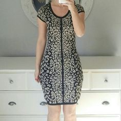 VS Leopard Print Cashmere Blend Sweater Dress This dress is so soft! Leopard print with interesting black details that really make this dress stand out.  Fitted style that hits slightly above the knee. Short sleeved. Worn once! In perfect condition! 3% cashmere. True to size. Victoria's Secret Dresses