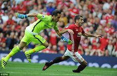 Henrikh Mkhitaryan (right) endured a torrid time on his full Old Trafford debut