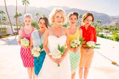 All these bridesmaids wore different colors, but kept it the same on bottom with a lace pencil skirt lined with a bright slip to match their top || via Brit + Co
