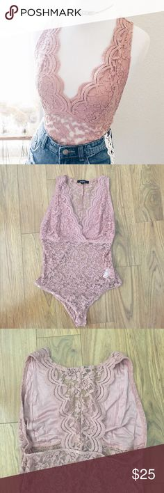 Lace bodysuit Beautiful mauve/rose colored plunging lace bodysuit. Brand new, never worn! Ordered online so it didn't come with tags. The top part is lined with racer back. Snaps on the bottom. So gorgeous! Only selling because I ordered two and kept the one that fit  Tops Tank Tops