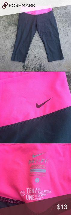 Nike DryFit Pink Gray Capri Legging Athletic Pants Stew cut and comfortable yoga pants. Pink wide band at top and gray leggings capris. Size large. Nike Pants Leggings