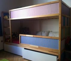 This configuration is actually two KURA beds and two MALM underbed storage drawers on casters which provide storage