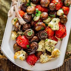 Italian Roasted Mushrooms and Veggies - absolutely the easiest way to roast mushrooms, cauliflower, tomatoes and garlic Italian style. Simple and delicious. #veganDishes