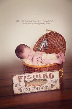 Newborn Boy in Fishing Basket - Studio Photography
