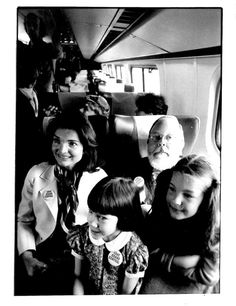 "youngfirstlady: Jacqueline Kennedy Onassis and Henry Geldzahler, with Nancy Menapace, front left, daughter of Municipal Art Society President Ralph Menapace and right, Ariel Hyatt, daughter of Gordon Hyatt on the April 1978 ""Landmarks Express"" train to Washington, D.C. focusing national media attention on the Penn Central case and the effort to save Grand Central."