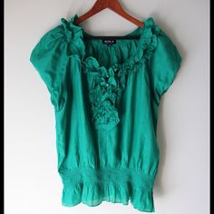 """Green ruffle top Green ruffle front top - front half button closure - elastic hemline - short sleeves - cotton/silk combo - slightly darker green than in photos - chest across measures 21"""" - total length measures 26"""" - size L Allen B. Tops"""
