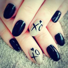 Black almond nails with XO ring finger nail design