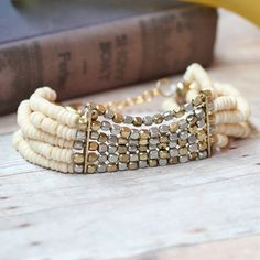 Beaded bracelet in ivory, gold, and silver via Ruche