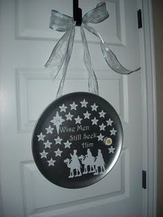 Christmas countdown, (you can't really see the numbers on the stars but they're there!) They were a $4 pizza pan from Walmart, and then I added the vinyl and made a matching magnet from a flat marble, and sprayed it all with glitter spray. They were very easy and people loved them.