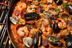Grilled Paella Mixta - Paella with Seafood and Meat (Serves 6 to 8) : : : Paella, the classic grilled rice dish from Spain, is perfect for a barbecue because everything cooks together in one pan and absorbs the smoky flavor from the fire. The key to this dish is the crusty caramelized layer of rice, called socarrat, that forms on the bottom of the pan.