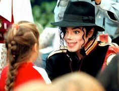 I love the look on his face! Full of wonder and delight for that little girl. <3