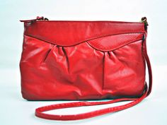 Adorable cherry red, 1980s clutch shoulder bag. A classic look with a funky fun twist. Wear her with anything! #FrankieMarieVintage #Rehcy #FrankieMariebyRehcy #1980s #80s #eighties #red #lipstickred #cherryred #clutch #vintageclutch #80sClutch #Purse #Handbag #Crossbody #ClassicStyle #80sFashion #Vintage #VintageFashion #VintageShop #VintageStore