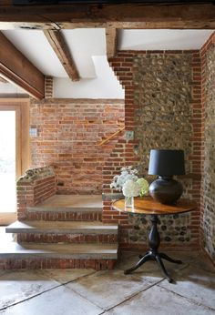 Real home: a 17th-century flint-and-brick granary barn is given a new lease of life | Real Homes