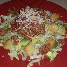 Taco salad my way.  #nofilterneeded So yummy. Ground up turkey meat add a little bit taco seasoning packet n some salsa. After cooking that put your sweater lettuce on the plate I bought mine pre-cut I used one avocado topped with shredded cheese I only put a handful of croutons because I didn't want to add too much carbs