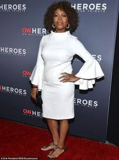 Bell of the ball! Actress Alfre Woodward wowed in a white cocktail dress with bell sleeves, opting for understated sandals on bottom