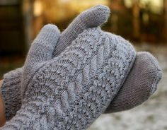 cable mittens... i'd definitely like to try these! i've never made mittens before, but these are so pretty!